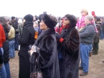 Elegantly dressed women beside us, to help welcome Obama
