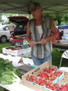 Tim Cahill, selling strawberries grown by himself, Peggy Cahill and Mike Cahill in Maidstone, VT