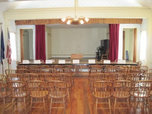 Town Meeting Hall, One Hour Before Meeting